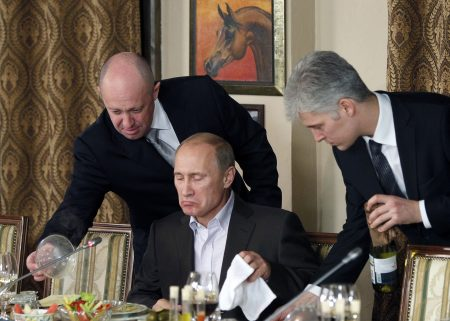 Russian Prime Minister Vladimir Putin sits during a dinner with foreign scholars and journalists at the restaurant Cheval Blanc on the premises of an equestrian complex outside Moscow November 11, 2011. Picture taken November 11.  REUTERS/Misha Japaridze/Pool (RUSSIA  - Tags: POLITICS) - RTR2TX34